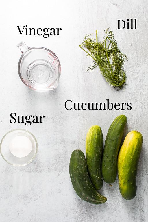 Vinegar, dill, sugar and cucumbers.