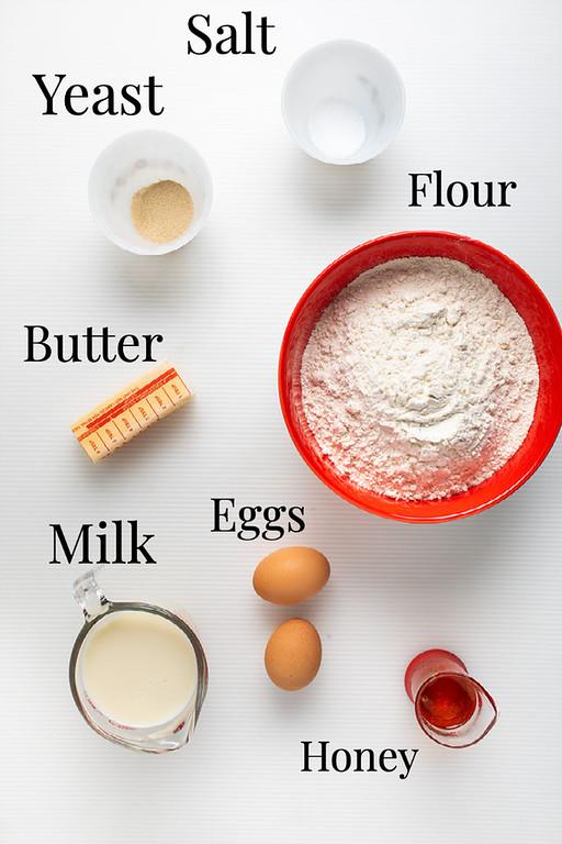 Salt, yeast, butter, flour, eggs, milk, and honey.