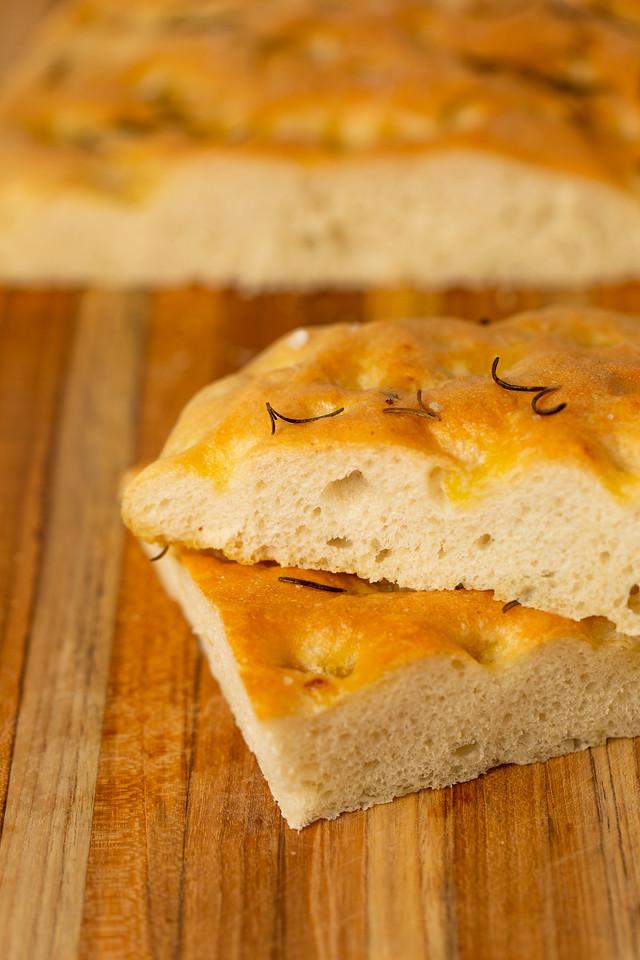 Focaccia bread on a cutting board.