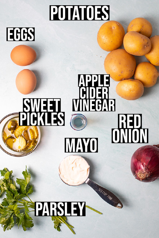 Potatoes, eggs, apple cider vinegar, sweet pickles, mayo, red onion and parsley