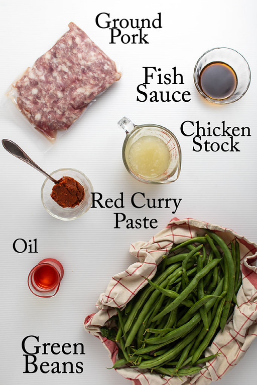 Ground pork, fish sauce, chicken stock, red curry paste, oil, and green beans.