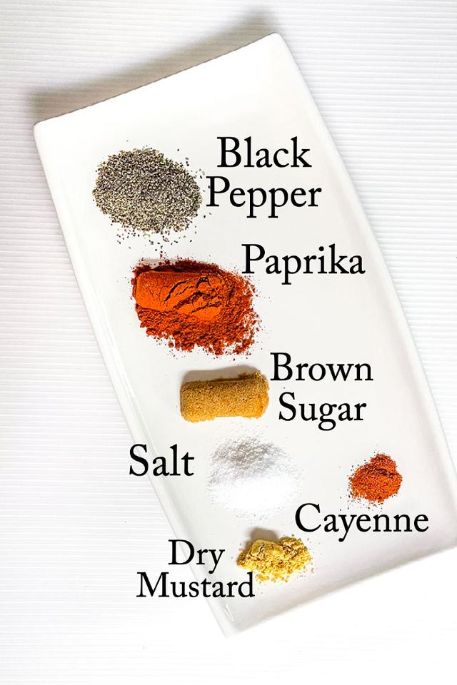 Black pepper, paprika, brown sugar, salt, cayenne and dry mustard.