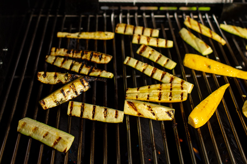 Zucchini and squash with grill marks on a grill.
