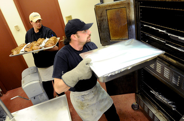 """Bill Sablask, right, and chef Rusty Mattinson, arrange the oven to cook the evening meal for the Colorado Buffalo athletes.<br /> For more photos of the cooking at Dal Ward, go to  <a href=""""http://www.dailycamera.com"""">http://www.dailycamera.com</a>.<br /> Cliff Grassmick / November 11, 2011"""