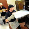 "Bill Sablask, right, and chef Rusty Mattinson, arrange the oven to cook the evening meal for the Colorado Buffalo athletes.<br /> For more photos of the cooking at Dal Ward, go to  <a href=""http://www.dailycamera.com"">http://www.dailycamera.com</a>.<br /> Cliff Grassmick / November 11, 2011"