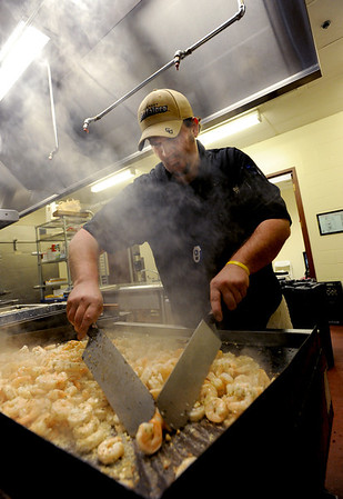 "University of Colorado athletics chef from Pasta Jay's, Rusty Mattinson, cooks shrimp for the evening meal for the Buffaloes at the Dal Ward complex.<br /> For more photos of the cooking at Dal Ward, go to  <a href=""http://www.dailycamera.com"">http://www.dailycamera.com</a>.<br /> Cliff Grassmick / November 11, 2011"