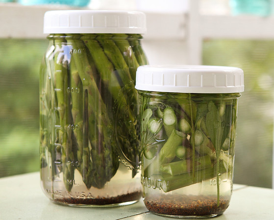 Two jars of pickled asparagus