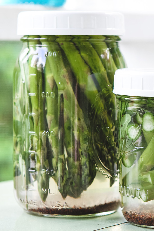Two jars of asparagus refrigerator pickles.
