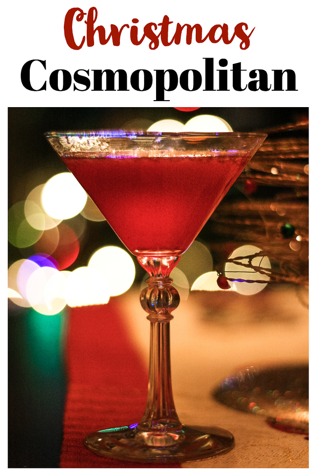 Red cocktail in front of a Christmas tree with text reading Christmas cosmopolitan