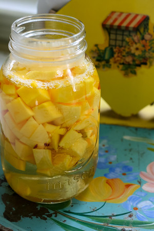 Jar filled with mango chunks