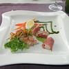 """A la minute tartaar van blue-fin tonijn en rolletjes Serrano ham op mousseline van vroege doperwtjes""<br /> (Paas-menu 2009)"