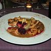 """""""Hertenkalf zadelfilet langzaam gegaard op 75°C met gewokte fazantenreepjes op schuimig sausje van Banyuls met dariole van wintergroentjes, aardpeerpuree en cranberries"""" (Sylvester-menu)"""