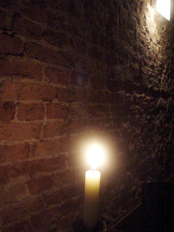 Candle lit tables and the original old brick stone walls