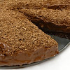<h1>Silken Chocolate Mousse Cake</h1> From Hannah Kaminsky's <i>My Sweet Vegan</i> cookbook.  This dessert is wonderfully rich, and chocolatey, and smooth!!  The middle layer was not as firm as the cookbook's picture, probably because it needed more time to chill in the refrig.  (I only gave it 4 hours).  Oh gee ... too bad!!   Didn't affect the taste one iota!!   My non-vegan co-workers devoured the entire thing in half an hour!!  This one's super easy to make .... the food processor does all the work.   You just mix, and pour into the pan and chill (no baking needed).  Hannah said to use a carrot scraper to make chocolate curls for the topping.   I never could get the hang of that, so I just used a microplane grater and got the wonderful topping of grated chocolate on top that way!  No flour at all in this ... totally gluten free!  The bottom crust is a wonderfully chewy almond meal-cocoa mixture.