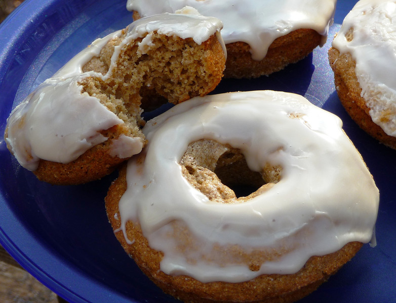"""<h1>Baked Maple Donuts</h1> These tasty things are a breeze to mix up, and so delic !   I often make them in the morning before going to work, and bring them along for my co-workers (so I don't eat the whole dozen that the recipe makes myself!!)  I made half the batch gluten free by substituting a <u><b><a href=""""http://www.amazon.com/Bobs-Red-Mill-Gluten-Free-All-Purpose/dp/B000KEPBCS"""">gluten free flour mix</a></b></u> for the pastry flour called for in the recipe.  When I compared the two versions side by side (gluten and gf) I could not tell A BIT of difference, either in texture or taste!!  <u><b><a href=""""http://veganfeastkitchen.blogspot.com/2008/10/vegan-mofo-vegan-baked-doughnuts-two.html"""">Recipe here</a></b></u> (recipe #1)."""