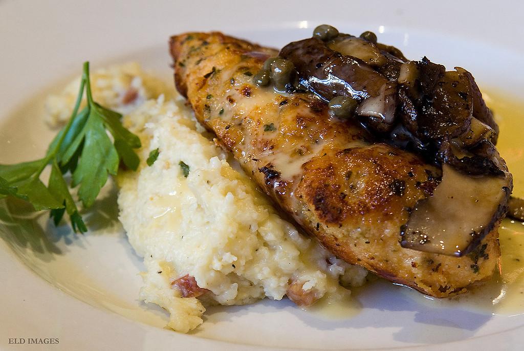 Paneed Chicken & Grits -<br /> Parmesan & herb crust, mushroom fricassee, lemon caper butter -  Ralph Brennan's Jazz Kitchen, Anaheim CA