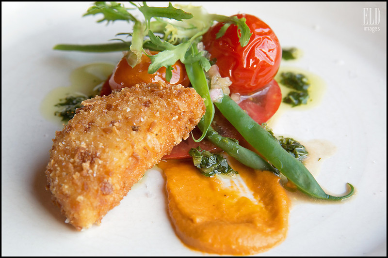"""A Salad Can Be Very Filling"" - Art of the Table<br /> Heirloom tomato, oil poached cherry tomato, chevre croquette, arugula, tomato butter, green beans, basil oil, sherry vinaigrette..."