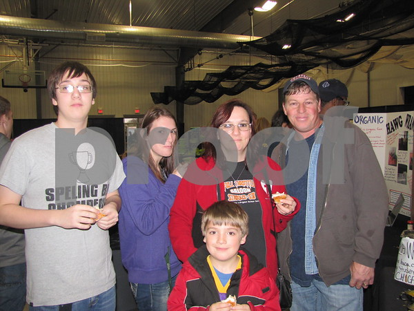 Tyler Jewell, Brittany Jones, Char and Ryan Harris, and Grant Harris (front)