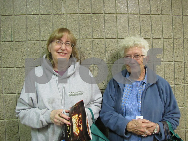 Mary Mertz and Delores Hovores wait to get into the Taste of Home Cooking School.