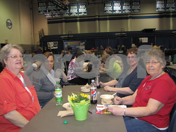 Marilyn Johnson, Rebecca Kennedy, Sue Hefty, and Betty Barber enjoyed a snack purchased from a booth from Hy-Vee before the cooking school.