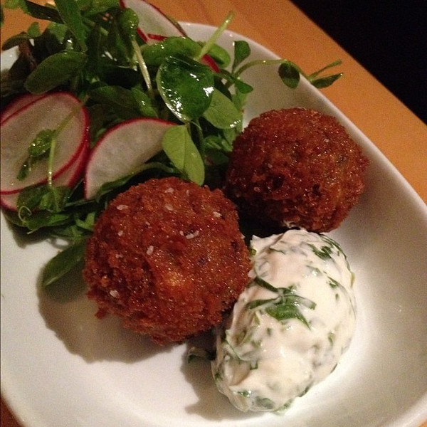 Curried lamb+rice+pea croquette, sorrel yogurt, pea tendril salad.