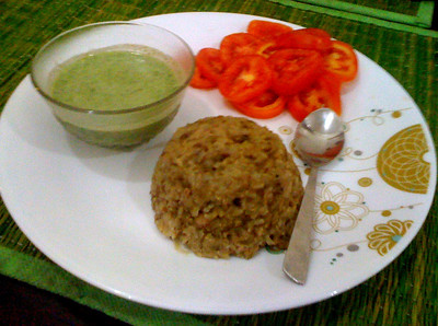 Dinner: Brown rice and whole green moong dal kichdi, cilantro raita, and sliced tomatoes.