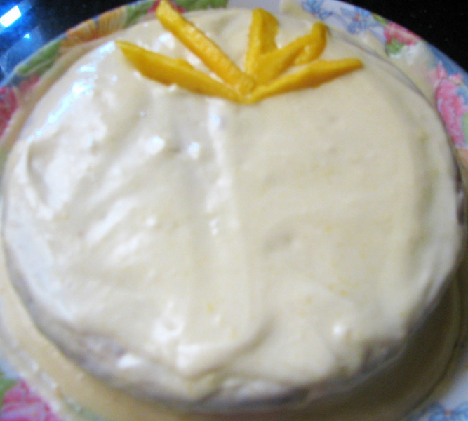 Eggless Mango Cardamom cake, with a Mango Buttercream Icing.