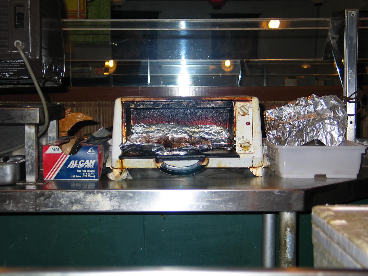 Ah, this is where the Salmon Skin Sashimi cooks, where's the smoke signal;-)