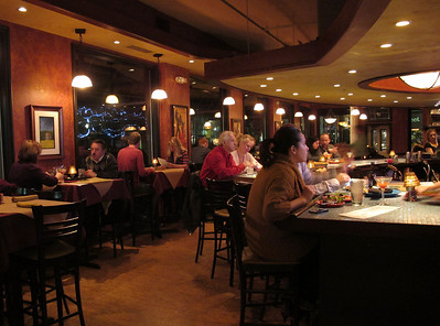 The dining room and bar are filled with guests at Fandango Tapas Bistro, 247 S. Kalamazoo Mall in downtown Kalamazoo, Michigan.  (Bradley S. Pines | Contact: BSPines@Gmail.com)