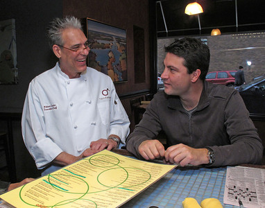 William Canter, executive chef, left, chats with owner Adam Fenaud at Fandango Tapas Bistro, 247 S. Kalamazoo Mall in downtown Kalamazoo. Their restaurant celebrated their seventh anniversary in February 2012.  (Bradley S. Pines | Contact: BSPines@Gmail.com)
