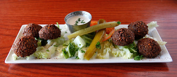 The Spicy Egyptian Falafel features fava bean falafel balls with jalapeno, garlic, cilantro, cumin, and black pepper ($5.95) at Zooroona restaurant & lounge, 1710 West Main Street, in Tiffany's Village shopping center in Kalamazoo, Mich. This dish is a spicy contrast to a non-spicy falafel dish, which Zooroona also offers.  (Bradley S. Pines / CONTACT: bspines@gmail.com) 4/11/12