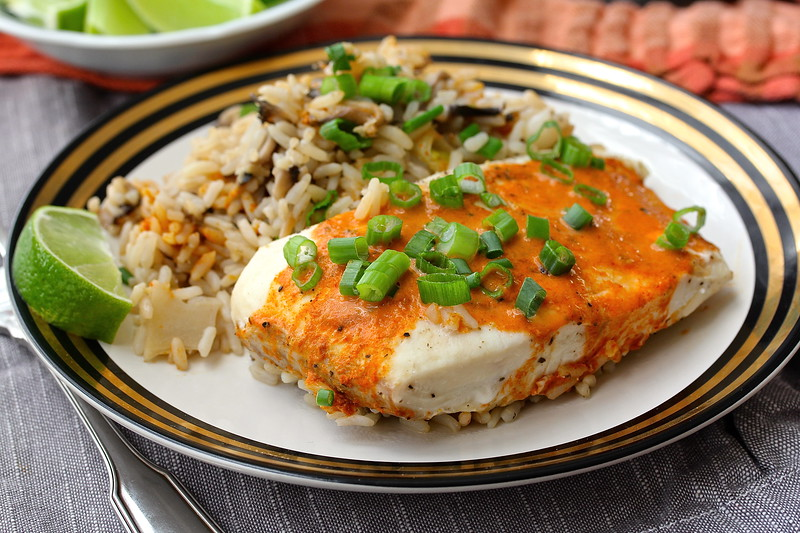 This Coconut Red Curry Halibut with Rice is deliciously flavored with ginger, scallions, mushrooms, and with bamboo shoots adding a nice crunch.