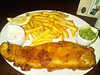 "Fish & Chips - large cod fillet in parsley infused batter served with fries, mushy peas and tartare sauce. Served in ""Harvester""  07/12/12"