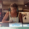 Janet's Chili Dogs food truck on Water Street in Fitchburg, run by owner Debby Tecsi of Fitchburg. Debby Tecsi prepares an order (seen through screen which is in the windows for summer). (SUN/Julia Malakie)