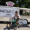 Janet's Chili Dogs food truck on Water Street in Fitchburg, run by owner Debby Tecsi of Fitchburg. Bo Burton of Leominster, a mechanic who works nearby, stopped by on his bike to pick up a Coca Cola. (SUN/Julia Malakie)
