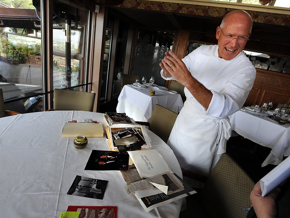 "Mark Monette is entertained by some historical photos of the Flagstaff House.<br /> The Flagstaff House is celebrating 40-years.<br /> For more photos and a video of the restaurant, go to  <a href=""http://www.dailycamera.com"">http://www.dailycamera.com</a>.<br /> Cliff Grassmick / September 9, 2011"