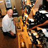 """Mark Monette shows off some rare bottle on wine, etc. in the Flagstaff House wine cellar.<br /> The Flagstaff House is celebrating 40-years.<br /> For more photos and a video of the restaurant, go to  <a href=""""http://www.dailycamera.com"""">http://www.dailycamera.com</a>.<br /> Cliff Grassmick / September 9, 2011"""