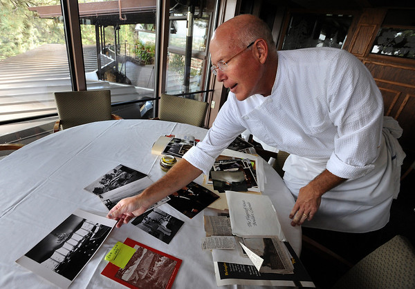 "Mark Monette looks over some historical photos of the Flagstaff House.<br /> The Flagstaff House is celebrating 40-years.<br /> For more photos and a video of the restaurant, go to  <a href=""http://www.dailycamera.com"">http://www.dailycamera.com</a>.<br /> Cliff Grassmick / September 9, 2011"