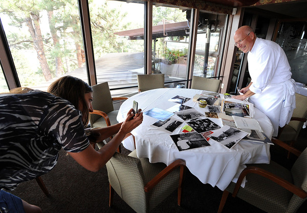 "Kuvy Axe, left, takes a photo of Mark Monette at the Flagstaff House.<br /> The Flagstaff House is celebrating 40-years.<br /> For more photos and a video of the restaurant, go to  <a href=""http://www.dailycamera.com"">http://www.dailycamera.com</a>.<br /> Cliff Grassmick / September 9, 2011"