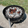 Put some wood chunks on the coals. Mesquite in this case.