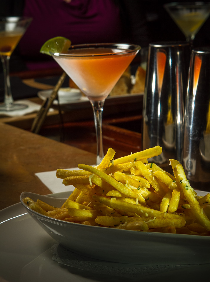 The Truffle Fries with the #4 Cocktail at 231 Ellsworth restaurant in San Mateo, Calif.  is seen on Thursday, January 31st, 2013.