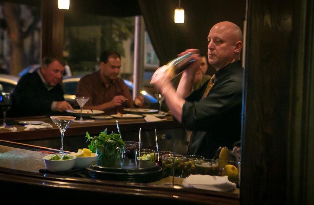 Bartender Dan Brown shakes a Martini at 231 Ellsworth restaurant in San Mateo, Calif. on Thursday, January 31st, 2013.