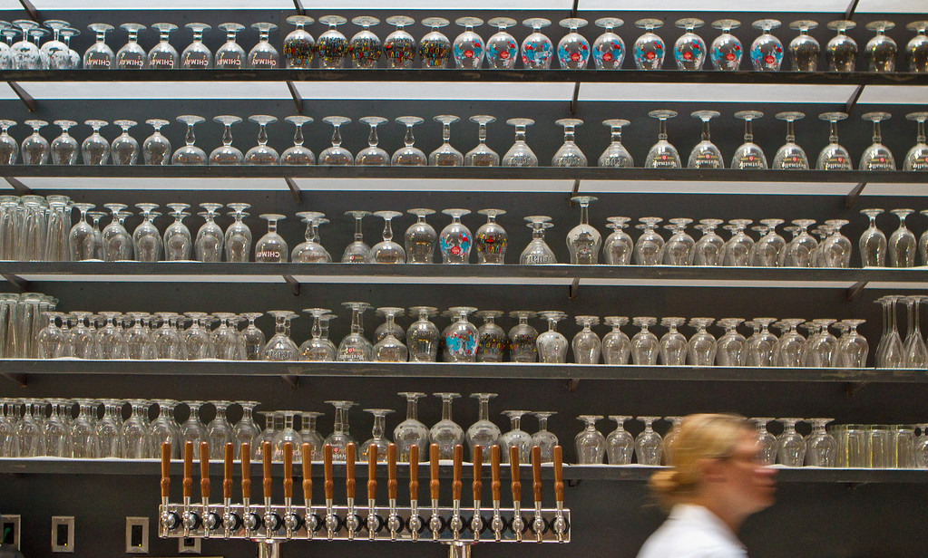 The wall of glasses at Abbot's Cellar in San Francisco, Calif., is seen on Thursday, Sept. 27th, 2012.
