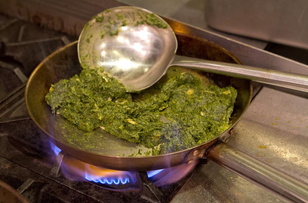 Sous Chef Arindam Bahel cooks the Chwonke Palak at Amber Dhara restaurant in San Francisco, Calif., on October 5th, 2012.