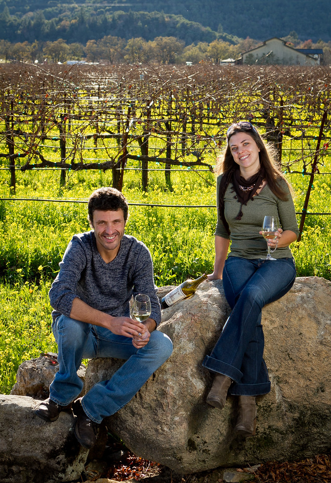 Letizia Pauletto and Enrico Bertoz of Arbe Garbe Winery with their wine in a vineyard next to their home in Rutherford, Calif., on Friday, December 16th,  2011.