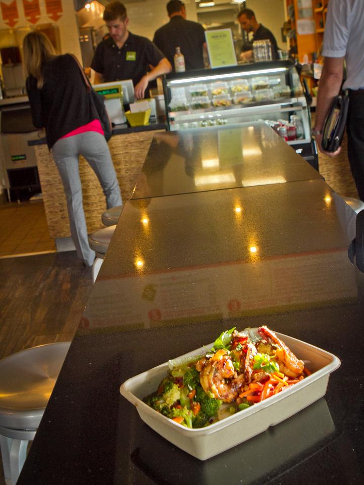 Basil Lime Shrimp over Asian Vegetable Salad box at Asian Box restaurant in Palo Alto, Calif., is seen on Thursday, Oct.11th, 2012.