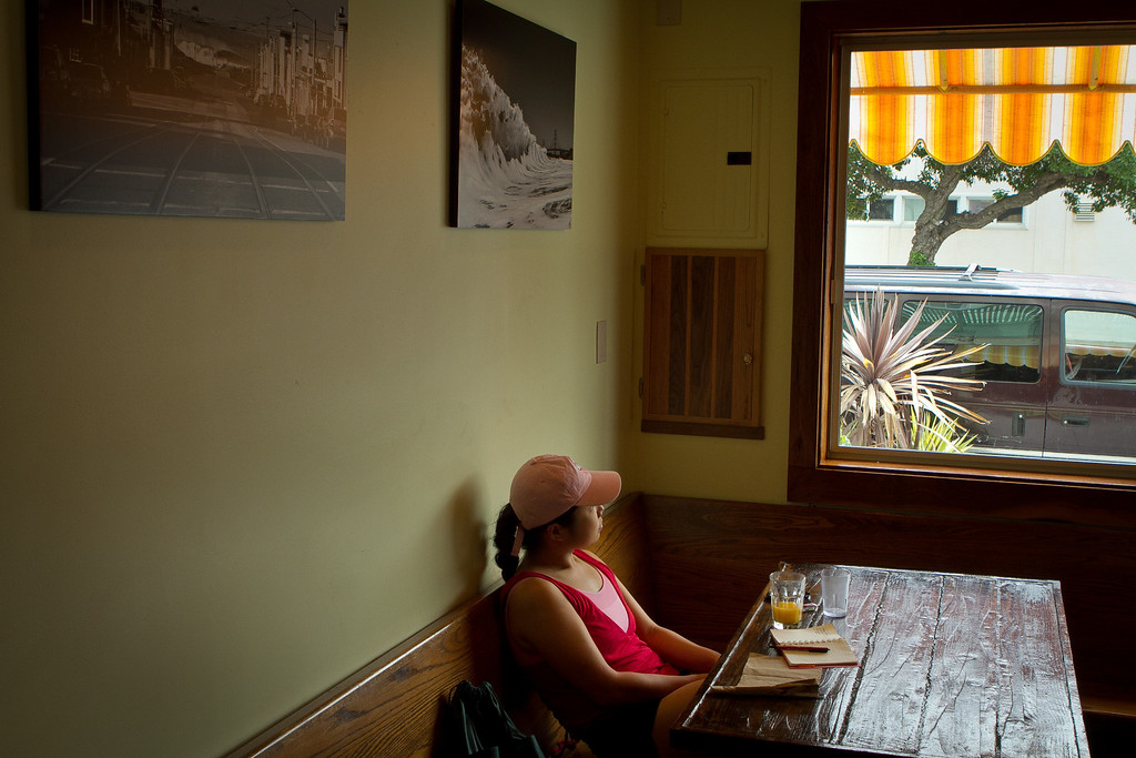 A woman looks out the window during lunch at the Beachside Coffee Bar in San Francisco, Calif. on March 29th, 2012.