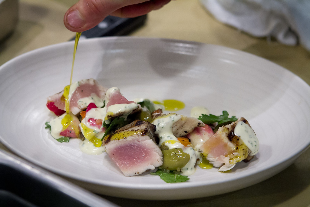 The grilled Albacore gets a drizzle of Olive Oil at Beerworks in Mill Valley, Calif., on Friday, October 12th, 2012.