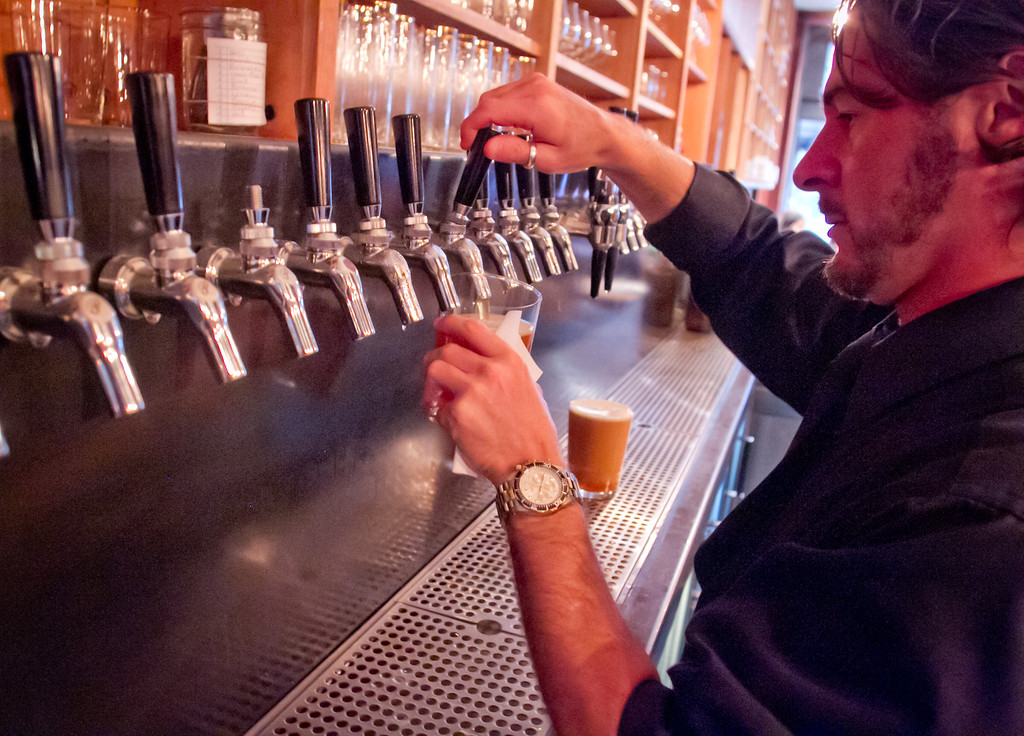 Christian Azimendi draws a beer from the tap at Beerworks in Mill Valley, Calif., on Friday, October 12th, 2012.