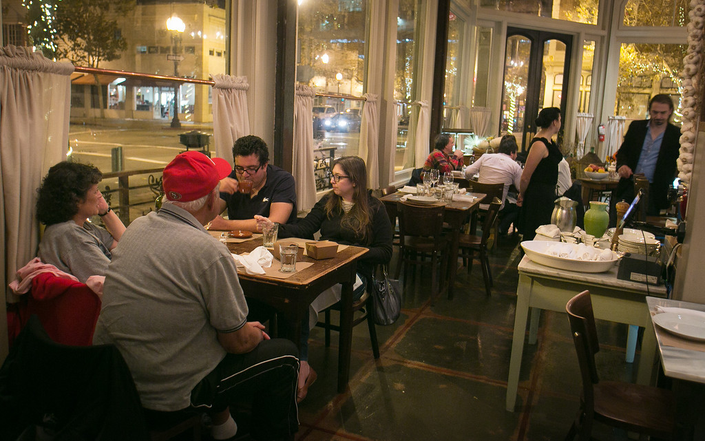 Diners enjoy dinner at Borgo Italia in Oakland, Calif., on Wednesday, November 21st, 2012.